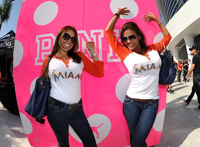 Marlins fans Mayra Hernandez (right) and Liliana Sanchez pose for a photo before opening day against the St. Louis Cardinals at Marlins Ballpark.