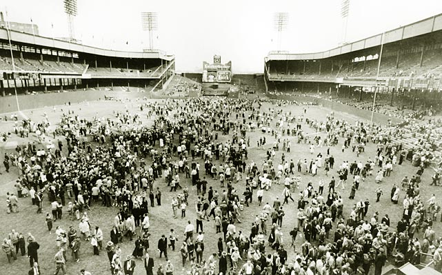 Fans linger on the field after the final Giants' game at the Polo Grounds. Both the Giants and the Dodgers moved to California after their 1957 seasons.