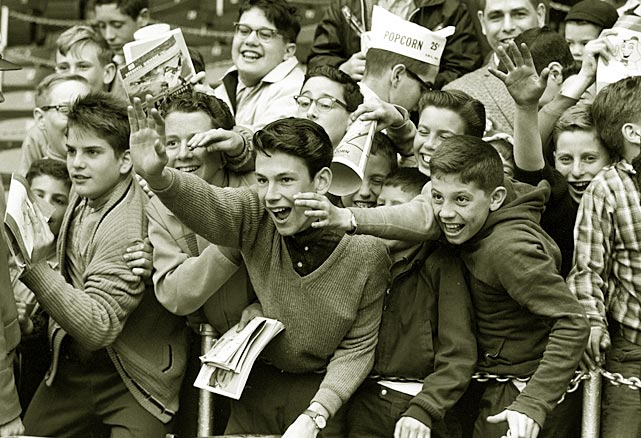 Some young Mets fans wave to a player before an April 1963 game.
