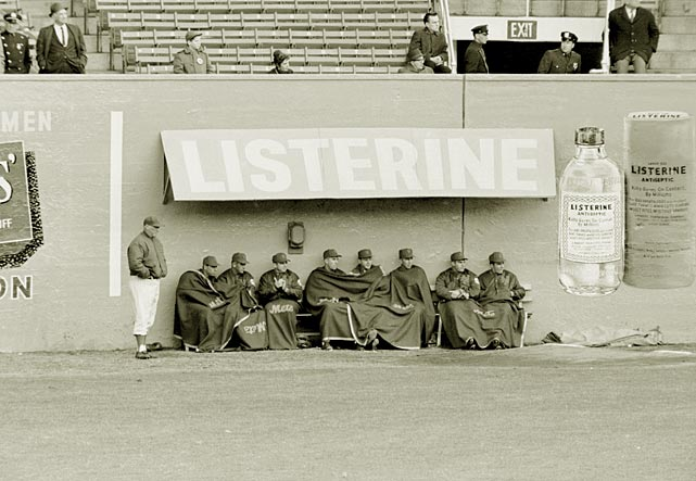 Huddled under blankets and sitting under an awning advertising mouthwash, the New York Mets watch on-field action during their inaugural 1962 season. The Mets, who set the all-time record in 1962 for losses in a season with 120, played at the Polo Grounds in 1962 and 1963 before moving to Shea Stadium in 1964.
