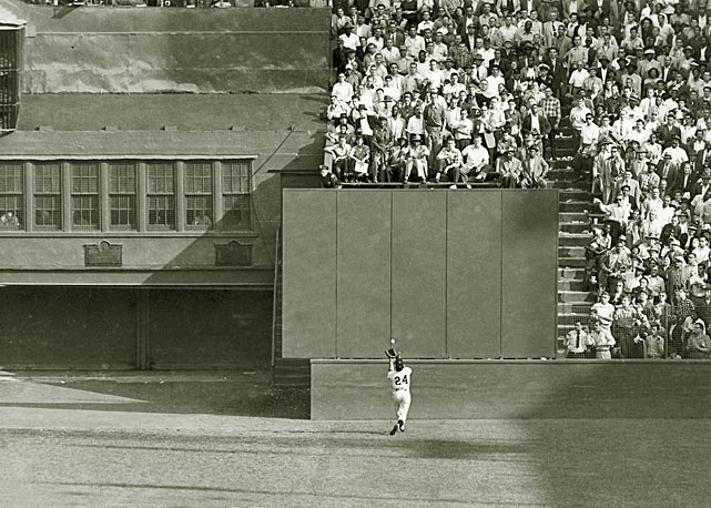 Mays makes his iconic over-the-shoulder catch deep in center during the eighth inning of Game 1 of the 1954 World Series. The catch preserved a 2-2 tie and allowed the Giants, who swept the series, to win the game in the 10th inning.