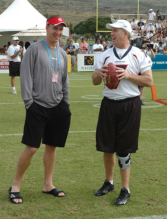 Manning spends some time with Broncos legend John Elway before the 2006 Pro Bowl skills challenge. Manning is expected to sign with another NFL team within the next week.