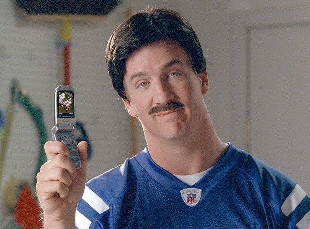 Manning sports a fake moustache in a Sprint commercial, one of many television spots he's been in over the years.