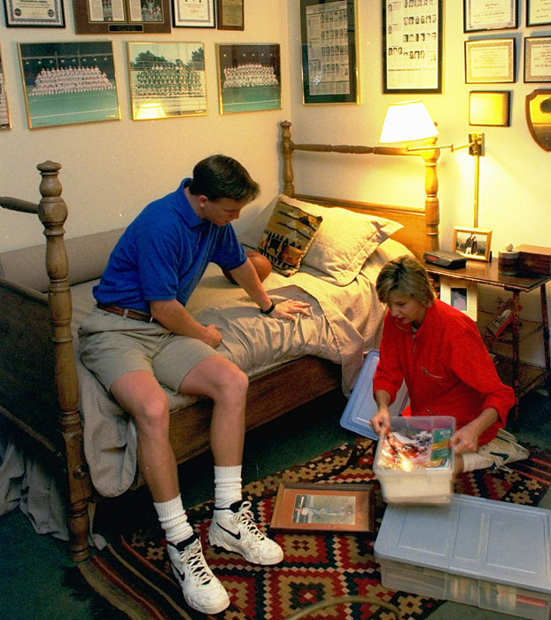Peyton and mom Olivia sort through stuff in his bedroom at their home in New Orleans.