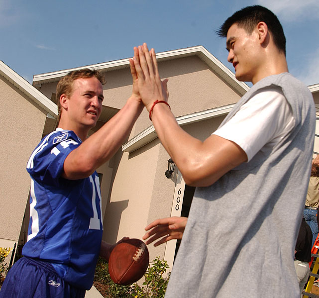 Manning and Yao Ming slap hands at a Gatorade commercial shoot.