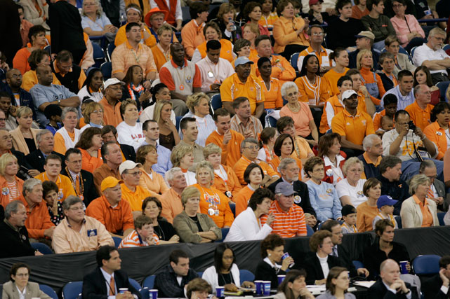Manning (center, pointing) takes in a Tennessee Lady Vols basketball game. Manning was 39-6 in four years at Tennessee.