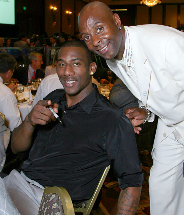 "STAT (""Standing Tall and Talented,"" his nickname) and former NFL great Jerry Rice buddy up at the Cedars-Sinai Sports Spectacular in June 2007."