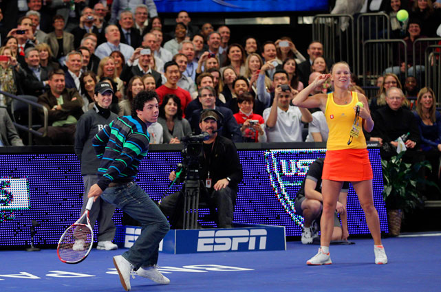 McIlroy won a point off Sharapova.   Here's video.