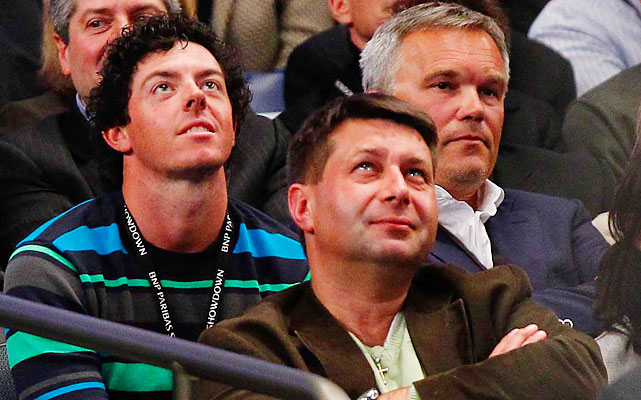 Rory McIlroy, Wozniacki's boyfriend, watched alongside Wozniacki's father, Piotr (right).