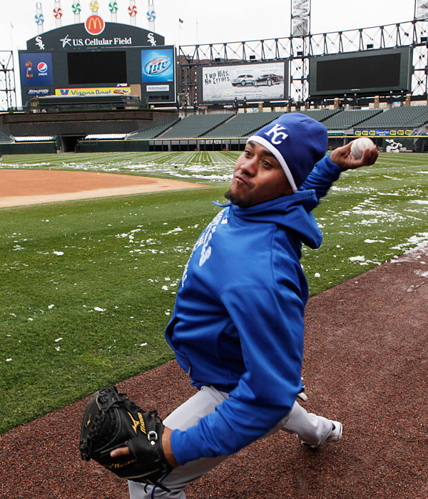 Royals catcher Miguel Olivo throws at US Cellular Field after a game against the White Sox was postponed due to snow.
