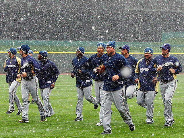 Milwaukee Brewers players jog in the snow at Great American Ball Park in Cincinnati before their season opener against the Reds. The Brewers open their 2011 major league baseball season Thursday against the Cincinnati Reds in Cincinnati.