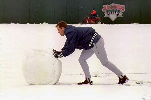 Yankees pitcher Kenny Rogers rolls a giant snowball to build a snowman at Jacobs Field after a spring storm dumped four inches of snow in the Cleveland area, postponing the Yankees-Indians game.