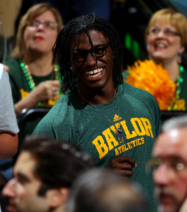Former Baylor quarterback Robert Griffin III sits in the Denver stands to cheer on his Lady Bears.