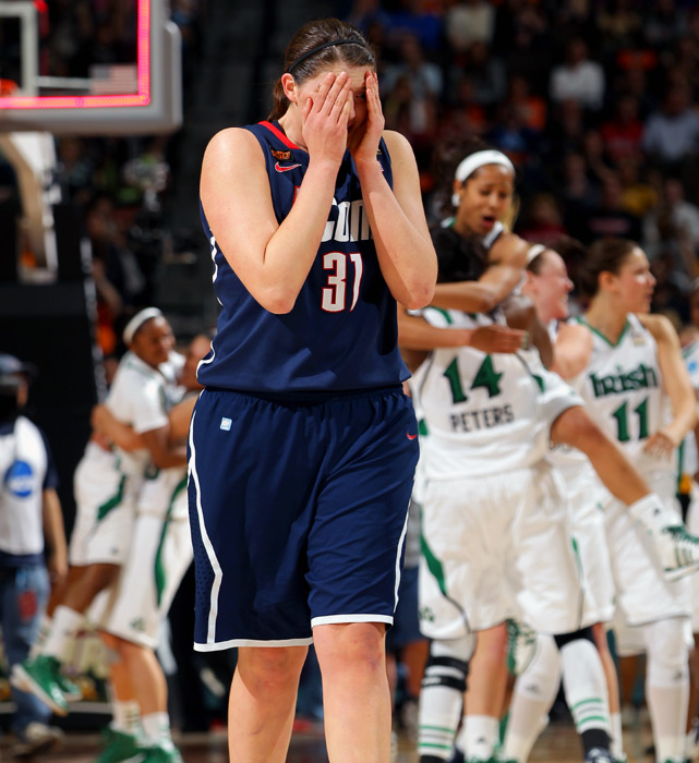 Stefanie Dolson, who overcame foul trouble to total 20 points and nine rebounds in a losing effort, walks off the floor as the Irish celebrate their victory.