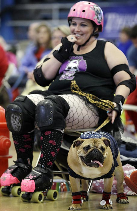 Leanne Sergio, of Ankeny, Iowa, sits with her dog Mya.