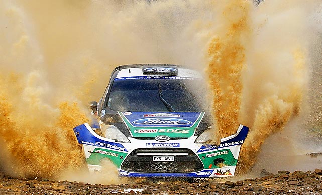 Norway's Petter Solberg and his co-driver Chris Patterson, from Britain, nearly lose the front of their car during the Portugal FIA World Rally Championship.