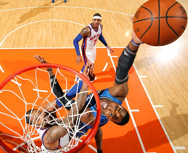 Dwight Howard attempts to score against Tyson Chandler of the New York Knicks during their game at Madison Square Garden.
