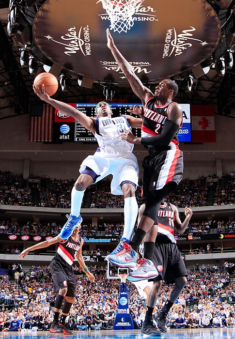 Mavericks guard Jason Terry goes in for a layup against Trail Blazers forward J.J. Hickson at the American Airlines Center. The Trail Blazers would go on the win 99-97.