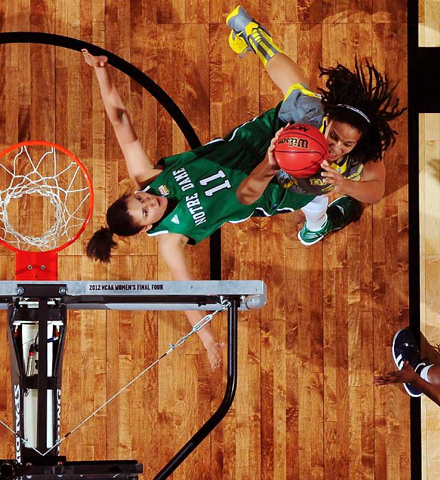 Baylor star Brittney Griner soars over Notre Dame's Natalie Achonwa during the women's national championship game. The Lady Bears became the first collegiate team to reach a 40-0 season.