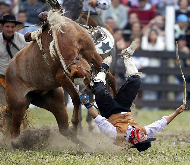A gaucho is bucked off by a horse during the celebration of Criolla Week in Montevideo.