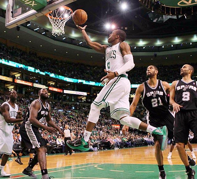 Celtics point guard Rajon Rondo (9) serves up a layup during Boston's 87-86 loss to the San Antonio Spurs.