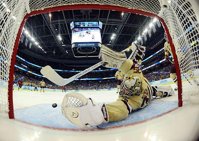 Boston College goalie Parker Milner dives for a save during the 2012 Frozen Four Final in Tampa, Fla. Milner made 27 saves en route to BC's 4-1 victory over Ferris State.