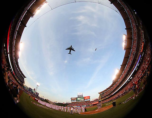 Players and fans watch Opening Day's military flyover prior to the Royals-Angels game.