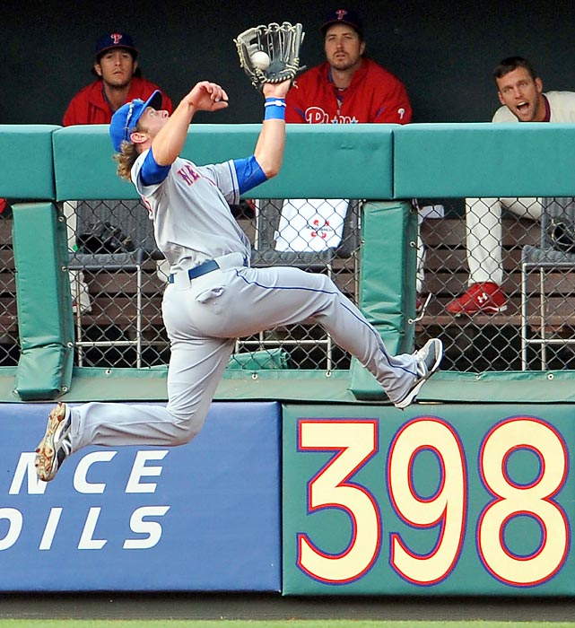 New York Mets Kirk Nieuwenhuis makes a leaping catch, much to the dismay of those in the Philadelphia Phillies bullpen.