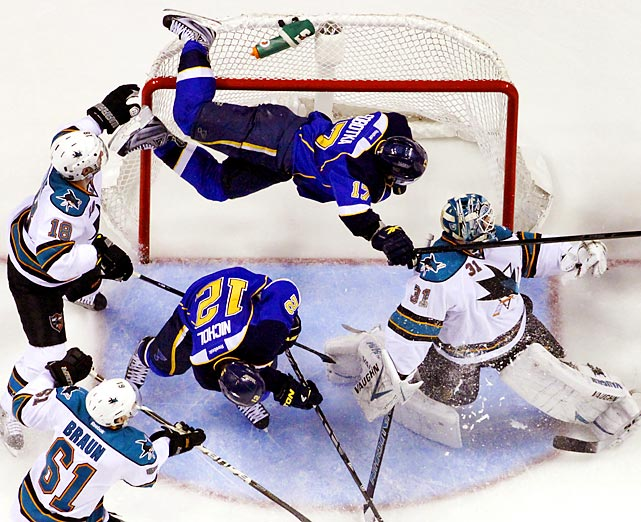 St. Louis Blues' Vladimir Sobotka (top), goes flying into the goal over San Jose Sharks goalie Antti Niemi during Game 2 of their playoff series.