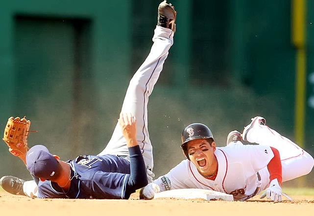 Boston's Jacoby Ellsbury yells in pain as he slides into second base, with Tampa Bay shortstop Reid Brignac landing on top of him. Ellsbury left the game with an injured elbow.