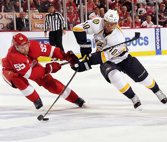 Detroit Red Wings Niklas Kronwall battles Nashville Predators Martin Erat for the puck during the third game of their playoff series.