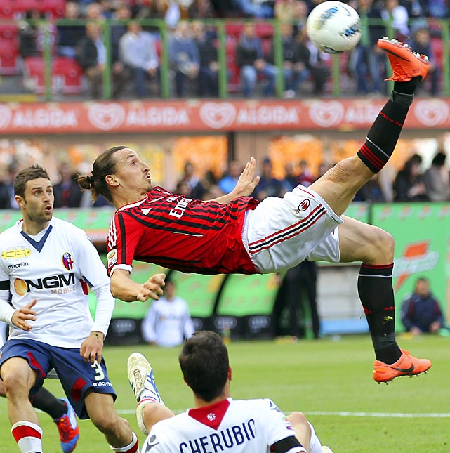 AC Milan's Zlatan Ibrahimovic kicks overhead during the team's Serie A match against Bologna at San Siro stadium in Milan, Italy.