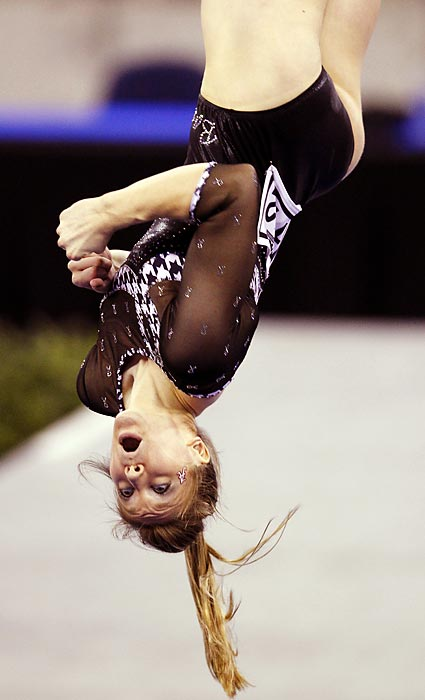 Alabama's Geralen Stack-Eaton flips while competing in the balance beam portion of the NCAA individual gymnastics championships in Duluth, Ga. Stack-Eaton would go on to win the event.