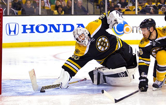 Capitals right wing Mike Knuble scores as Bruins goalie Tim Thomas narrowly misses a save in Game 5 of the 2012 Eastern Conference quarterfinals at TD Garden. Washington would top Boston 4-3.