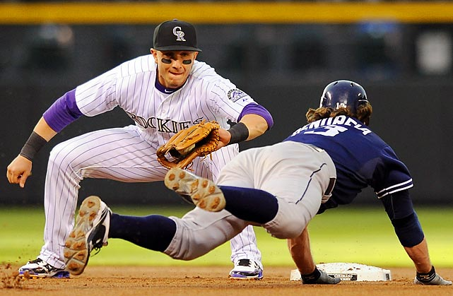 Rockies shortstop Troy Tulowitzki tags Chris Denorfia on an attempted steal of second base during the second inning of Colorado's game against the Padres.
