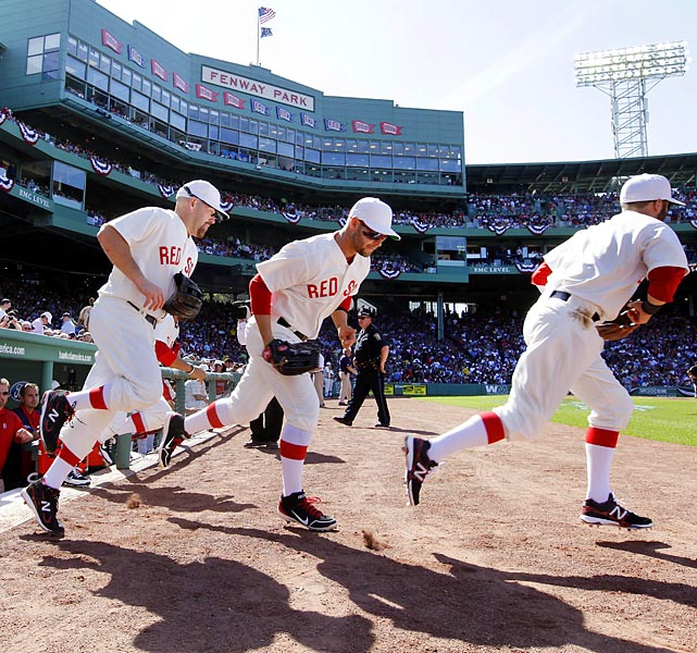 Red Sox players take the field, clad in 1912-era uniforms, during the 100th anniversary of Fenway Park.