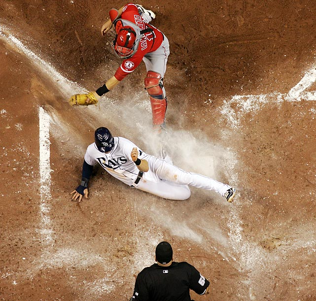 A member of the Tampa Bay Rays slides during a 3-2 win over the Los Angeles Angels of Anaheim at Tropicana Field.