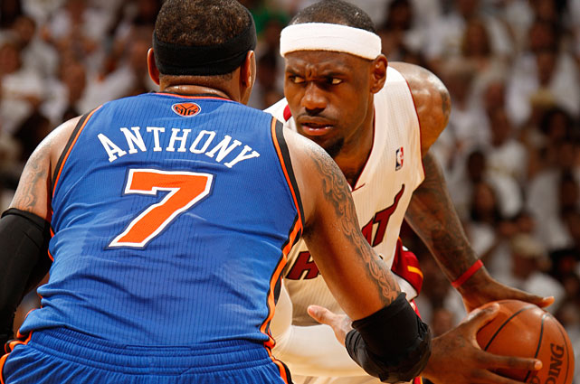 James appears frustrated by Anthony's defense during Game 1 of the Eastern Conference Playoffs. The series marks the first time the longtime rivals have faced off in the NBA playoffs.