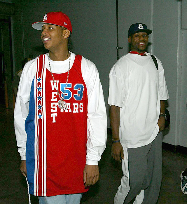 The duo arrive at the 2004 Rookie Challenge as Anthony pays tribute to Artis Gilmore.