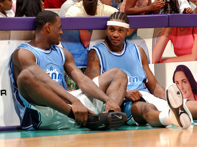 "James and Anthony chat while waiting to check into the game during Magic Johnson's 18th annual ""A Midsummer Night's Magic"" charity game at Staples Center in July 2003."