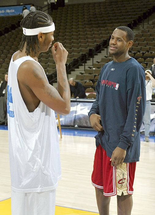 Anthony and James talk before a Dec. 2003 game.