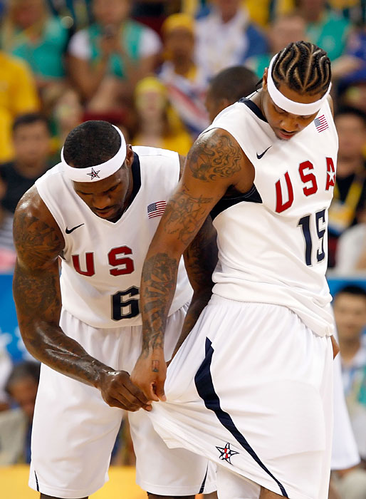 James straightens Anthony's shorts during the men's basketball quarterfinal game against Australia at the Olympic Basketball Gymnasium in Beijing.