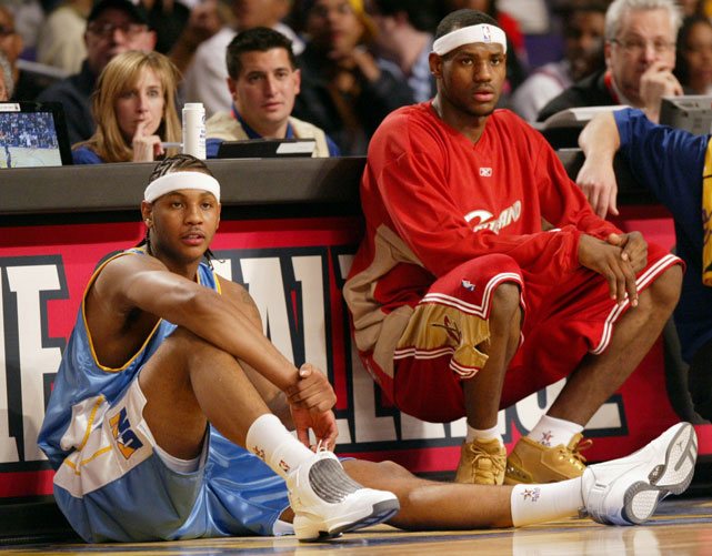 James and Anthony eagerly wait to get back into the game during the 2004 Rookie Challenge.