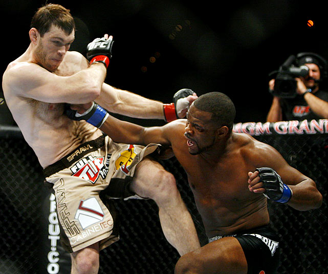 Evans scores a third-round knockout of Griffin to win the UFC light heavyweight championship.