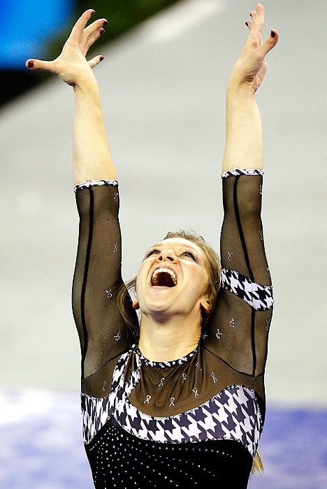 Alabama's Geralen Stack-Eaton reacts after finishing her winning routine on the balance beam.
