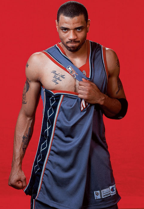Kenyon Martin shows off his tattoo during a 2002 SI photo shoot.