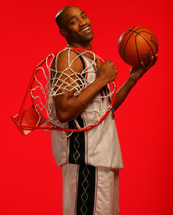 Vince Carter holds a souvenir rim during a 2006 SI photo shoot.
