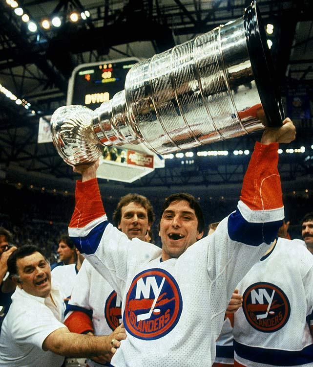 Overshadowed by such Hall of Famers as Mike Bossy, Bryan Trottier, Denis Potvin, Clark Gillies and Billy Smith, Carroll was a valuable face-off specialist and penalty-killer on three of the Islanders' four Cup teams (1981-83). Two years later, he was released, but had the good fortune of being claimed by the Oilers, who had begun a dynasty of their own. Carroll won his fourth Cup with them in 1985. He retired in 1987 after two seasons with Detroit.