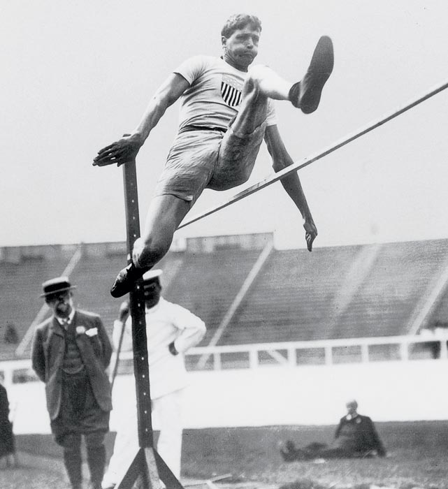 After overcoming polio as a child, Ray Ewry developed into one of the best standing jumpers ever. At the 1900 Olympics in Paris, Ewry won gold in the now-defunct standing long jump, standing high jump and standing triple jump. He successfully defended all three titles in 1904 and again won gold in the standing long jump and standing high jump in 1908. In all, Ewry finished his career with eight Olympic golds in eight opportunities.