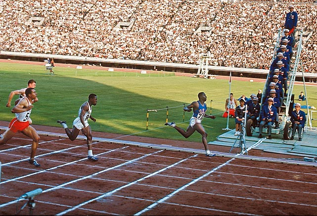 "Before Usain Bolt, there was Bob Hayes. ""Bullet Bob,"" as he's nicknamed, won gold in the 100 meters and anchored the 4x100 relay at the 1964 Olympics. In the relay, Hayes came from behind and made up nearly eight meters to win the gold for the U.S. Hayes was also the first to run the 100 in under 10 seconds, running a (wind-assisted) 9.91 in the semifinals. His time was unrivaled until 1996."